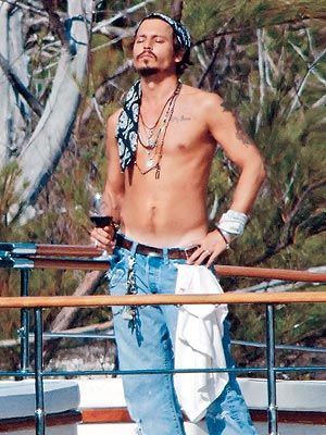 Johnny Depp  in bahamas while filming pirates of the caribbean 3. He loves his wine!