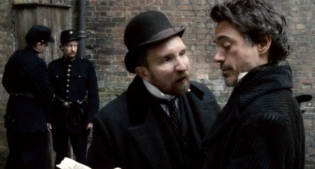 Eddie Marsan EDDIE MARSAN as Inspector Lestrade (center) and ROBERT DOWNEY JR. (far right) as Sherlock Holmes in Warner Bros. Pictures' and Village Roadshow Pictures' action-adventure mystery 'Sherlock Holmes,' distributed by Warner Bros. Pictures. Pho