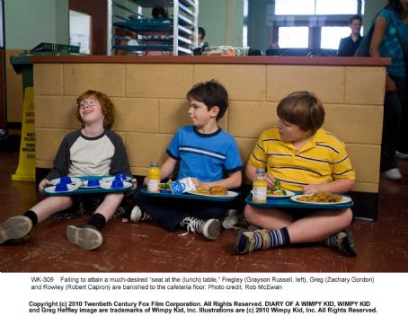 "Diary of a Wimpy Kid Failing to attain a much-desired ""seat at the (lunch) table,"" Fregley (Grayson Russell, left), Greg (Zachary Gordon) and Rowley (Robert Capron) are banished to the cafeteria floor. Photo credit: Rob McEwan"