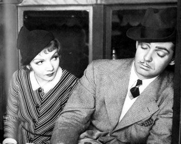 Claudette Colbert  and Clark Gable