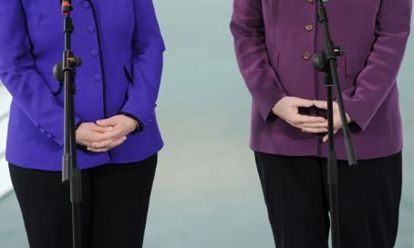 Hillary Rodham Clinton - Hillary Clinton and Angela Merkel joke about their mutual love of pantsuits