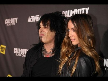 SANTA MONICA, CA - NOVEMBER 04: Musician Nikki Sixx and guest arrive at the exclusive the Call Of Duty: Black Ops Launch Party held at Barker Hangar on November 4, 2010 in Santa Monica, California. The party was held in celebration of the game, which laun