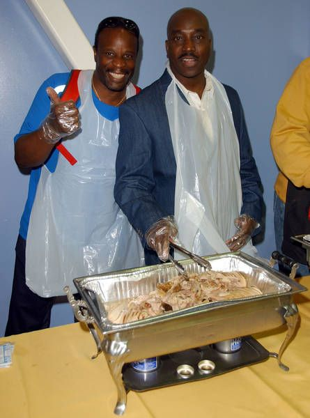 Grand L. Bush Grand L Bush and fellow actor Clifton Powell help the Mark Wahlberg Youth Foundation serve 600 dinners to at-risk youth and their families