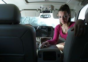 Ashley Leggat  in her car