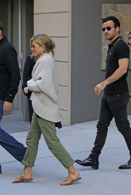 Jennifer Aniston and fiance Justin Theroux go furniture shopping on the Upper East Side in New York City. The 'Wanderlust' actress could be seen sporting a tattoo with her dog Norman's name on her foot, in remembrance of the pooches death in 2011. The cou