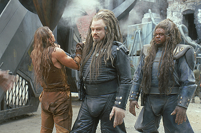 Battlefield Earth: A Saga of the Year 3000 Jonnie Goodboy Tyler (Barry Pepper) is confronted by Terl (John Travolta) and Ker (Forest Whitaker) in Warner Brothers' Battlefield Earth - 2000