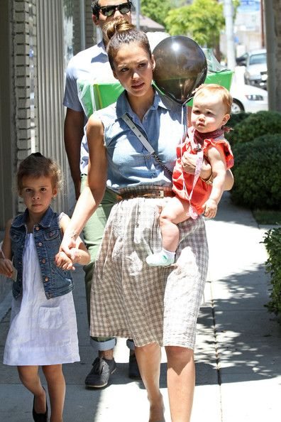 Jessica Alba seen with husband Cash Warren and two daughters Honor Marie and Haven going to a party in Hollywood