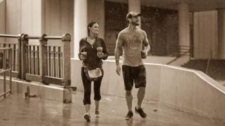 Amy Dumas - CM Punk and Lita walking in the rain
