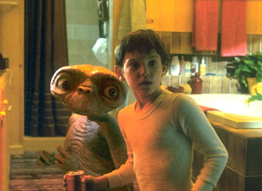 E.T. and Elliott (Henry Thomas) having a midnight snack.