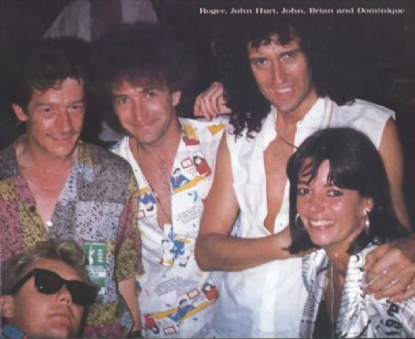 Roger Taylor  and Dominique Beyrand with John Deacon and Brian May