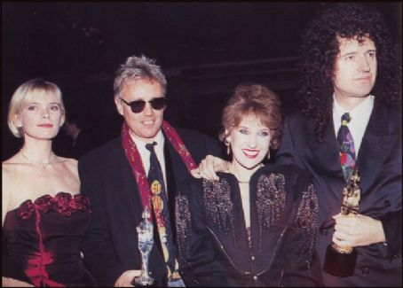 Roger Taylor  and Deborah Leng with Brian May and Anita Dobson