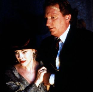 Catherine O'Hara and Jeffrey Jones in Beetle Juice (1988)
