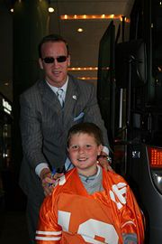 Peyton Manning  with a fan