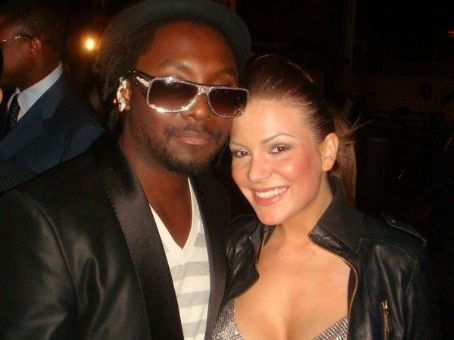 Will i Am will.i.am with his girlfriend Raya