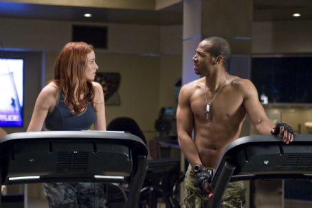 "Two members of the elite G.I. JOE team are SCARLETT (Rachel Nichols, left), a martial arts master and skilled in the use of the Crossbow Pistol, and RIPCORD (Marlon Wayans, right), an expert marksman and weapons specialist, in ""G.I. JOE: The Rise of"