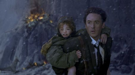Morgan Lily John Cusack and Lily Morgan, left, in Columbia Pictures' '2012.' The action film will be released November 13, 2009. Photo By: Joe Lederer.