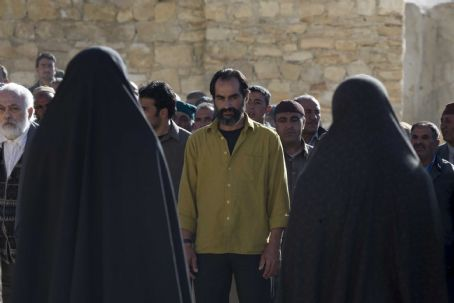 Navid Negahban Ali (), awaiting the beginning of the stoning in 'The Stoning of Soraya M.' All photos are Courtesy of MPower Pictures