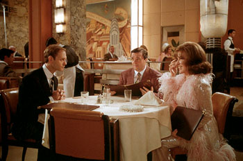 Bette Midler (right) as Jacqueline Susann and Nathan Lane (center) as her husband and manager Irving Mansfield meet with her editor Michael Hastings (David Hyde Pierce) in Universal's Isn't She Great - 1/2000