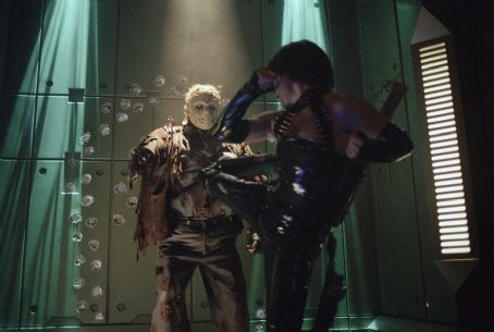 Kane Hodder Lisa Ryder battles  as Jason Voorhees in New Line's Jason X - 2002