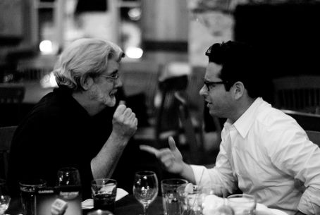 J.J. Abrams  in deep conversation with George Lucas