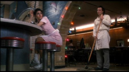 Caroline Christian Slater as Adam and Marisa Tomei as  in Untamed Heart  (1993)