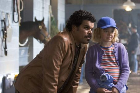 Cale Crane Luis Guzman (Balon) and Dakota Fanning () in Dreamer: Inspired by a True Story, 2005 release from Dreamworks
