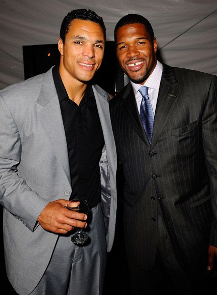Tony Gonzalez  and Michael Strahan