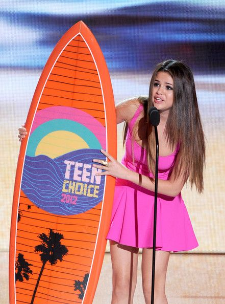 Selena Gomez accepts the Choice Music Group award onstage during the 2012 Teen Choice Awards at Gibson Amphitheatre on July 22, 2012 in Universal City, California