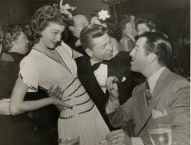 Ava Gardner and Mickey Rooney with Robert Taylor