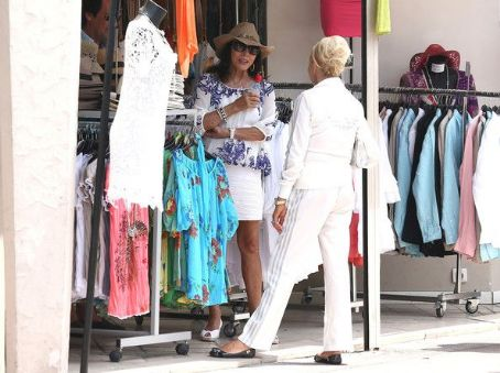 Joan Collins and her husband Percy Gibson meet with Ivana Trump in the streets of Saint Tropez while they were doing some shopping on July 1, 2012