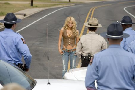 Daisy Duke JESSICA SIMPSON as  stars in Warner Bros. Pictures' and Village Roadshow Pictures' action comedy 'The Dukes of Hazzard,' also starring Johnny Knoxville and Seann William Scott and distributed by Warner Bros. Pictures.