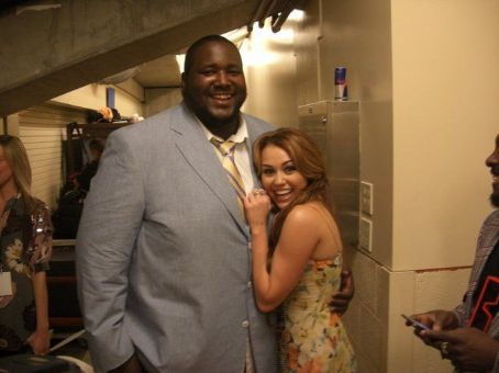 Miley Cyrus posed with The Blind Side Star, Quinton Aaron