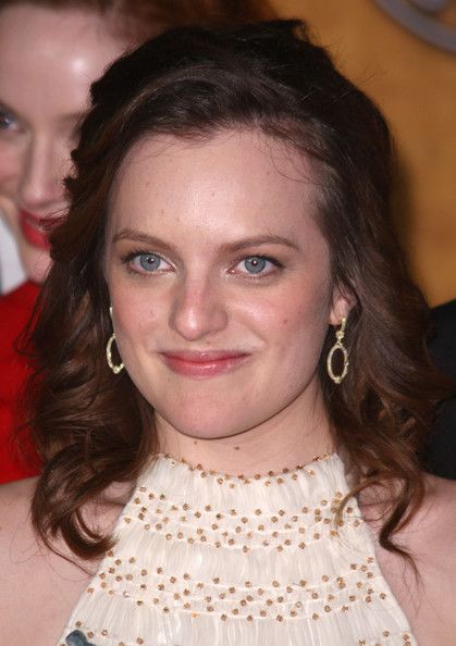 Elisabeth Moss Actress  poses with her award for Outstanding Performance by an Ensemble in a Drama Series for