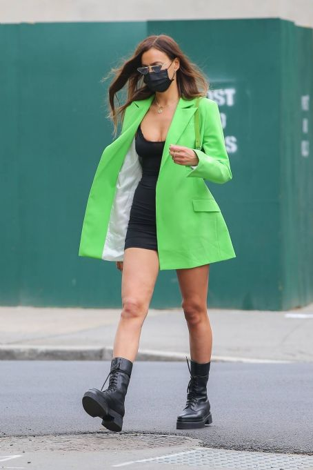 Irina Shayk – Wearing a lime green blazer over a mini dress