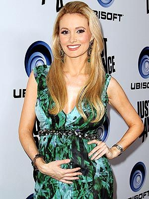 Holly Madison Glows In Green. Shows off baby Bump