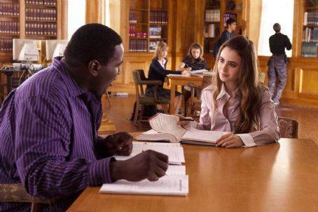 Lily Collins QUINTON AARON as Michael Oher and LILY COLLINS as Collins in Alcon Entertainment's drama 'The Blind Side,' a Warner Bros. Pictures release. Photo by Ralph Nelson