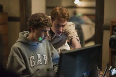 The Social Network Jesse Eisenberg, left, and Joseph Mazzello in Columbia Pictures' '.' Photo By: Merrick Morton. © 2010 Columbia Tristar Marketing Group, Inc. All rights reserved.