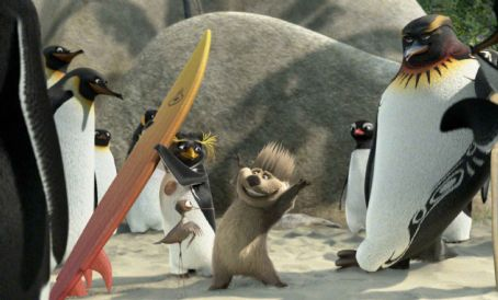 Surf's Up (left to right) Cody Maverick (voiced by Shia LaBeouf, background), Mikey (voiced by Mario Cantone, foreground), Reggie (voiced by James Woods), and Tank (voiced by Diedrich Bader) in Columbia Pictures/Sony Pictures Animation's Surf's Up.