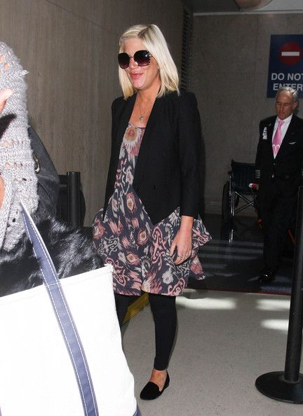 Tori Spelling was seen arriving at LAX in Los Angeles, California on April 6, 2012
