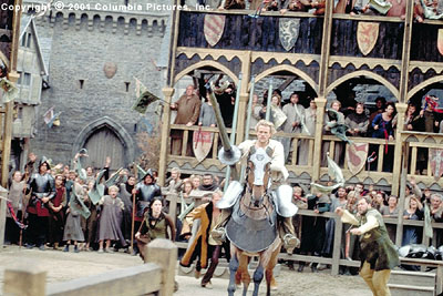 A Knight's Tale Amid the adrenaline-charged cries of spectators-including (from left to right, background) Kate (Laura Fraser), Chaucer (Paul Bettany) and Roland (Mark Addy), aspiring knight William (Heath Ledger, foreground) rides into fame in the Columbia Pictures pres