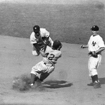 Jackie Robinson Jackie breaking up a Double Play