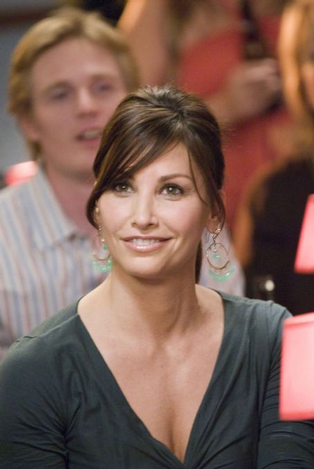 "P.S. I Love You GINA GERSHON as Sharon in Alcon Entertainment's romantic comedy "","" distributed by Warner Bros. Pictures. The film stars Hilary Swank and Gerard Butler. Photo by Phil Caruso. TM & © 2007 Warner Bros. Entertainment Inc. All"