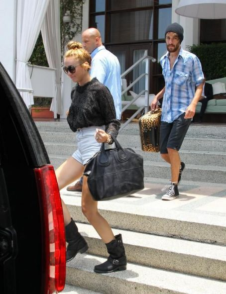 Miley Cyrus kicked off another work day in Miami today, June 15. She and her pal, Cheyne were spotted leaving their hotel and heading to the studio