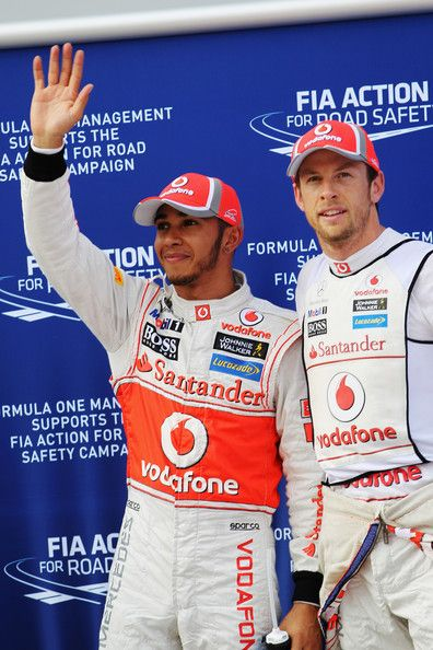 (L-R) Pole sitter Lewis Hamilton of Great Britain and McLaren and second placed Jenson Button of Great Britain and McLaren celebrate in parc ferme following qualifying for the Malaysian Formula One Grand Prix at the Sepang Circuit on March 24, 2012 in Kua