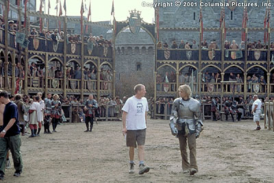 A Knight's Tale Writer/director/producer Brian Helgeland (left) and star Heath Ledger discuss a scene during the Prague-based filming of the Columbia Pictures presentation, A Knight's Tale - 2001