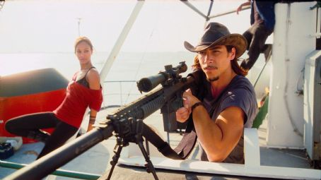 Cougar ZOË SALDANA as Aisha and OSCAR JAENADA as  in Warner Bros. Pictures' and Dark Castle Entertainment's action thriller 'The Losers,' released by Warner Bros. Pictures. TM & © DC Comics. Photo courtesy of Warner Bros. Pictures