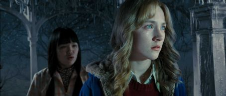 "Nikki SooHoo Nikki Soohoo (left) stars as Holly and Oscar® nominee Saoirse Ronan (right) stars as Susie Salmon in DreamWorks Pictures' ""The Lovely Bones,"" a Paramount Pictures release. Photo Credit: DreamWorks Studios. Copyright © 2010 DW STUDIOS L.L"