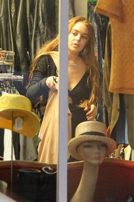 Lindsay Lohan taking her little brother Cody out to do some shopping in Venice (August 16)