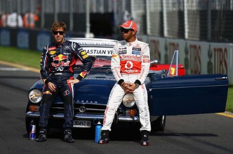 (L-R) Sebastian Vettel of Germany and Red Bull Racing and Lewis Hamilton of Great Britain and McLaren, two of the six F1 World Champions in this years field pose on the grid before during the Australian Formula One Grand Prix at the Albert Park circuit on