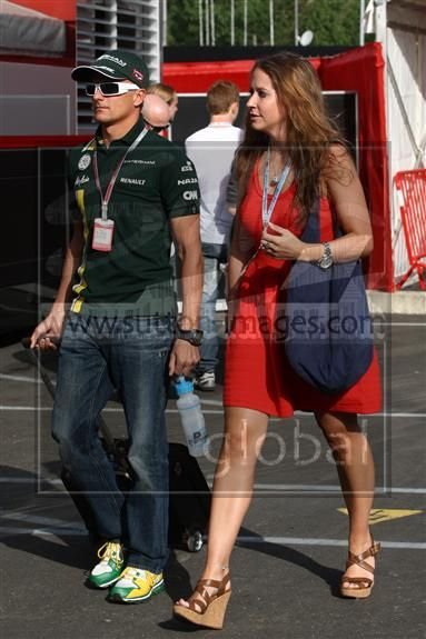 Heikki Kovalainen and Catherine Hyde - F1 - 2012 Spanish GP
